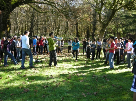 Giving out instructions for the outdoor team-building games.