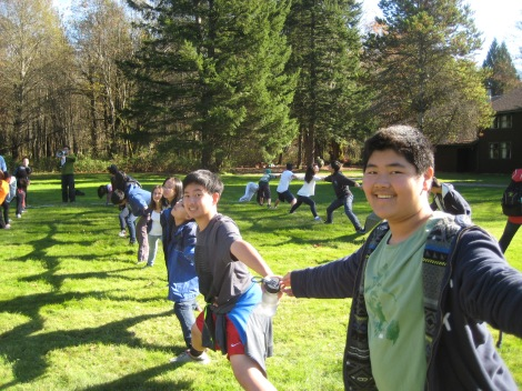 Students enjoying outdoor team-building games.