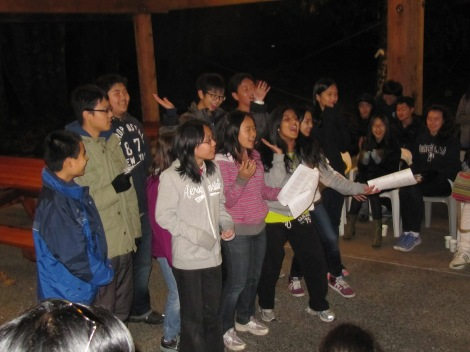 Enthusiastic team-led campfire singalong!